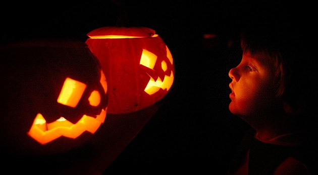 Children Enjoying Traditional Halloween Pumpkins