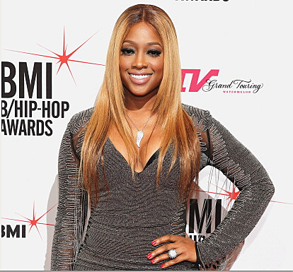 Rap star Trina rushed to the hospital after passing out.