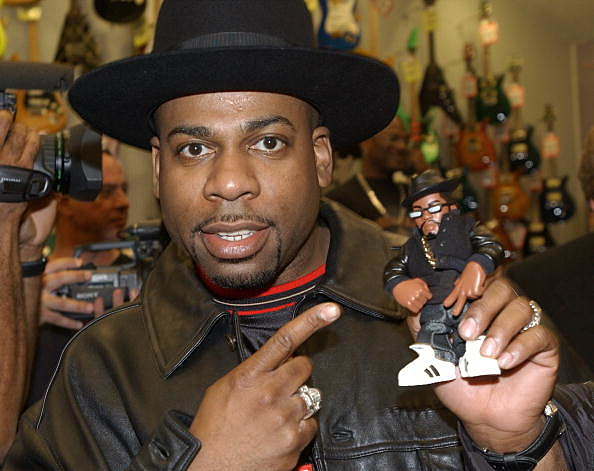 """401452 01:  (FILE PHOTO) Musical artist Jason """"Jam Master Jay"""" Mizell holds a toy figure of himself at a ceremony honoring his hip-hop group RUN-DMC's induction into the Hollywood RockWalk February 25, 2002 at the Guitar Center in Hollywood, California.  Mizell was shot and killed inside a Queens, New York studio October 30, 2002, according to a group representive. Police, who say two unidentified men were shot around 7:30 p.m. local time, have confirmed that one man was dead on arrival at a local hospital. (Photo by Vince Bucci/Getty Images)"""