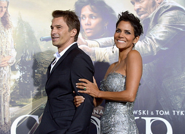 "HOLLYWOOD, CA - OCTOBER 24:  Actors Olivier Martinez and Halle Berry arrive at Warner Bros. Pictures' ""Cloud Atlas"" premiere at Grauman's Chinese Theatre on October 24, 2012 in Hollywood, California.  (Photo by Kevin Winter/Getty Images)"