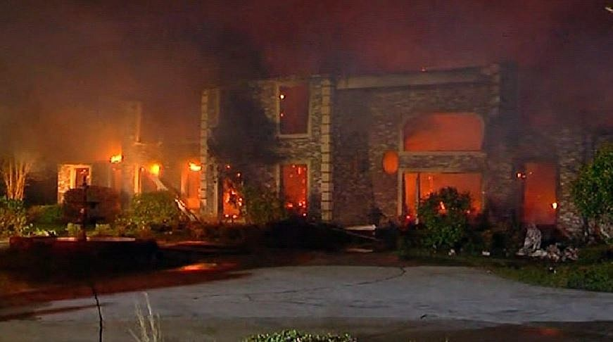 Emmitt Perry Sr. home burns to the ground - DailyMail via YouTube