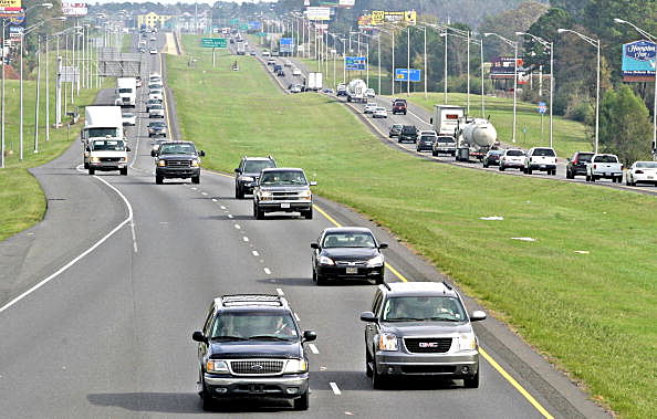 Motorists drive their vehicles along Interstate 20 in Shreve