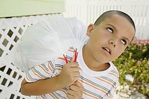 Boy Taking Garbage Out